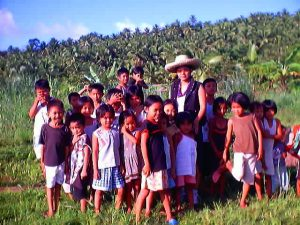 Dr. Dilodilo with some of the children in the Philippines